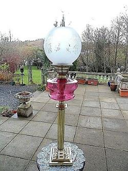 A Very Nice Cranberry Late Victorian Twin Duplex Table Oil Lamp