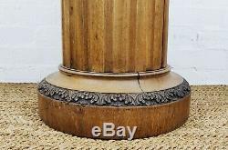 A late 19th century revolving pedestal