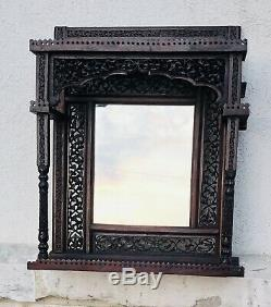 Antique Anglo Indian heavily carved Hanging Shelf and Mirror late 19th century