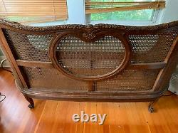 Antique French Louis XV Style Cane Back Sofa, Carved Walnut, Late 19th Century