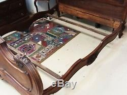 Antique French Louis XV style carved walnut bed. Late 19th century FULL SIZE