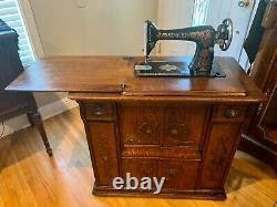 Antique LATE 1800's SEWING MACHINE CABINET. With Redeye sewing machine