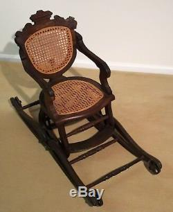 Antique Oak Folding High Chair and rocker from late 1800's with cane seat