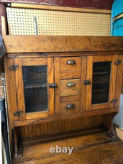 Antique baker's cupboard Late 1800's, tin grain bins, hammered glass doors
