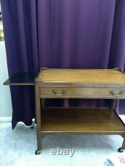 Baker Furniture Palladian Walnut and Cherry Bar Cart MCM from late 1960s