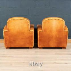 LATE 20th CENTURY PAIR OF ART DECO STYLE FRENCH LEATHER CLUB CHAIRS