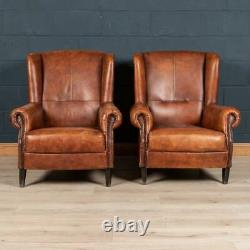 LATE 20th CENTURY PAIR OF DUTCH SHEEPSKIN LEATHER WINGBACK CHAIRS