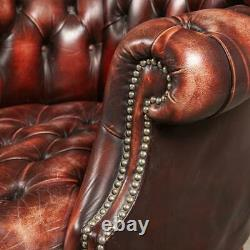 LATE 20th CENTURY PAIR OF ENGLISH LEATHER BARREL BACK ARMCHAIRS