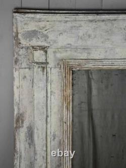 Late 18th Century Directoire trumeau mirror with grey patina 42½ x 43