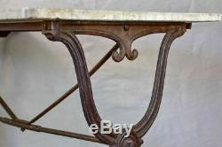 Late nineteenth century French marble presentation table with cast iron base 23¾